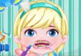 لعبة طفل إلسا زراعة الاسنان